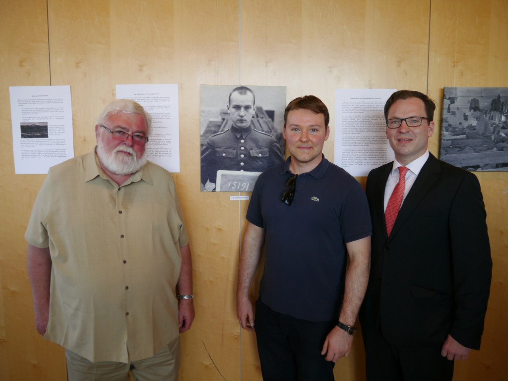At the exhibit on Oflag VII-A in the local high school, pictured on the wall is my grandfather, Kazimierz Bendisz, in 1939