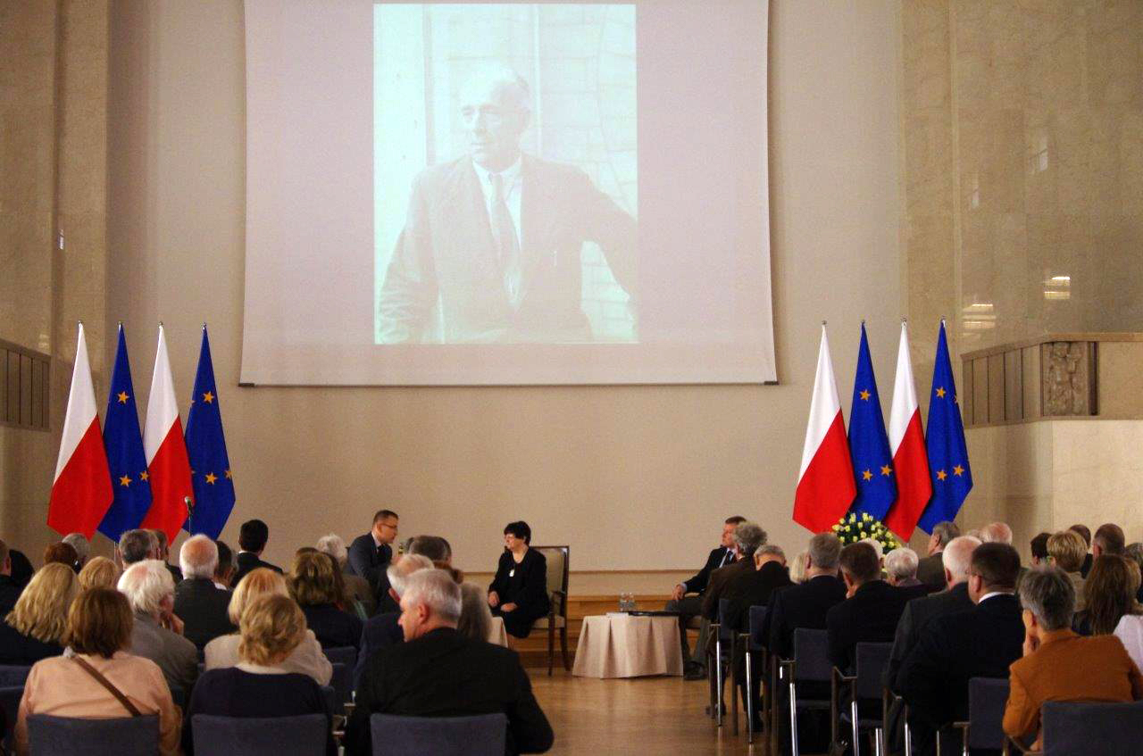 The promotional event for the biography of Kazimierz Skarżyński (pictured on the screen) in the Chancellery of the Prime Minister of Poland. (photo courtesy of The Head Office of the State Archives, Warsaw, Poland, M. Jurgo-Puszcz)