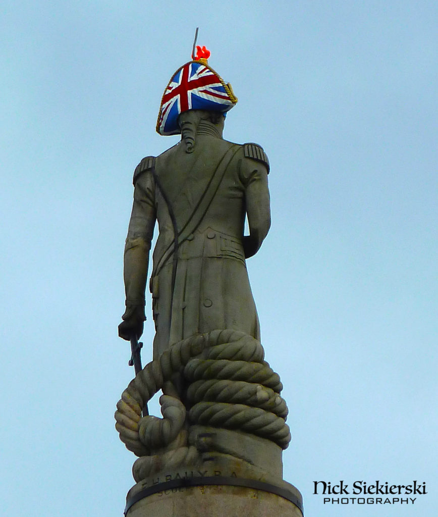 Admiral Horatio Nelson statue on Trafalgar Square, London with Union Jack on back of his hat