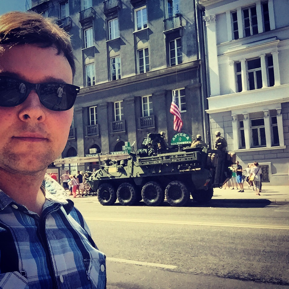 Me in front of an American Stryker vehicle at the Polish Armed Forces Day Parade in Warsaw, August 2015
