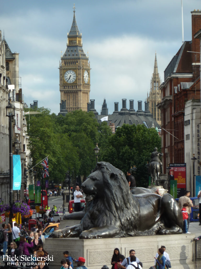 View of a lion statue and Big Ben from Trafalgar Square, London