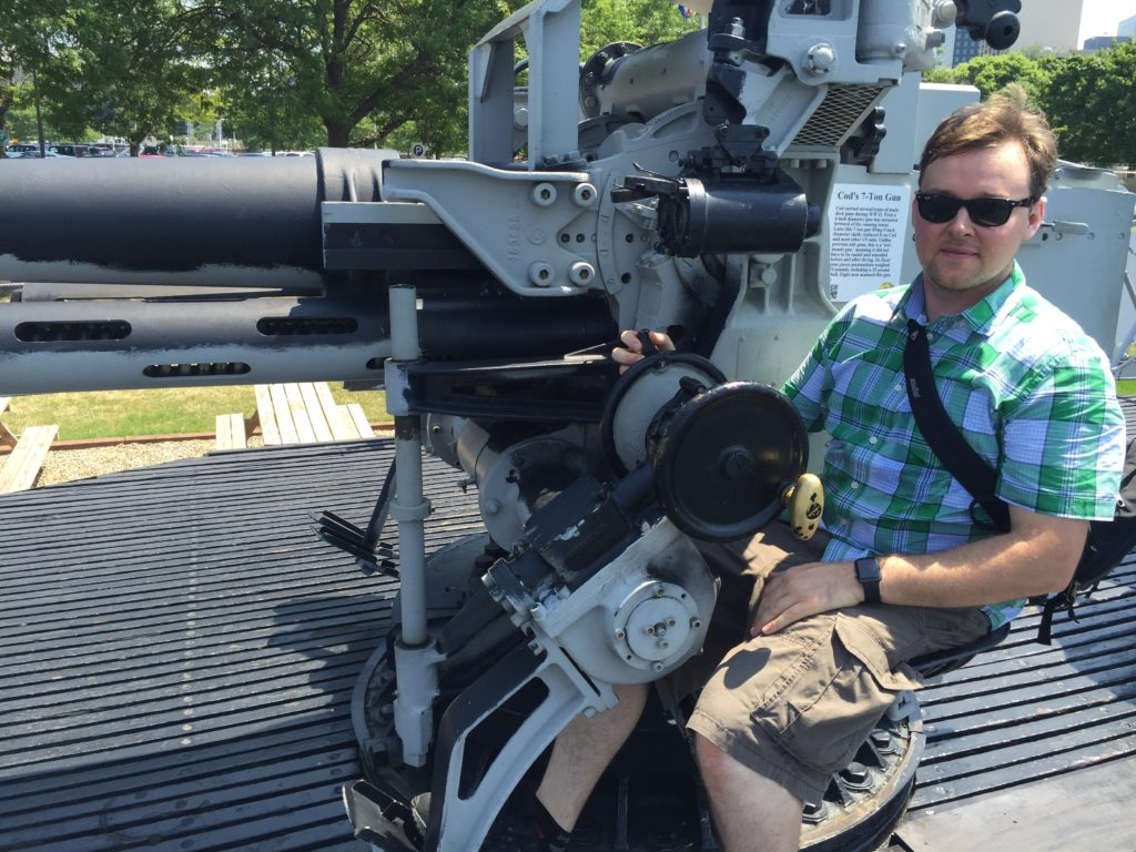 Sitting at the USS Cod's 7-inch gun