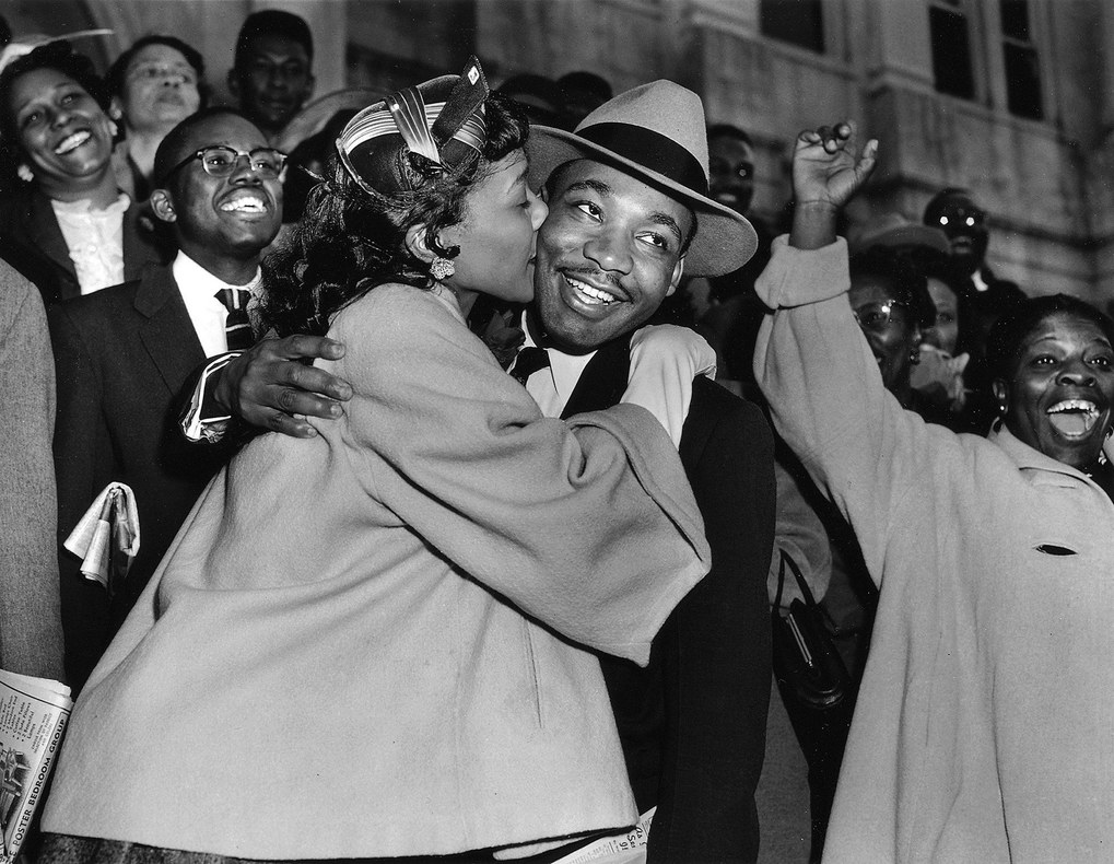 Martin Luther King Jr. is welcomed with a kiss by his wife Coretta after leaving court in Montgomery, Ala., in this March 22, 1956, file photo.