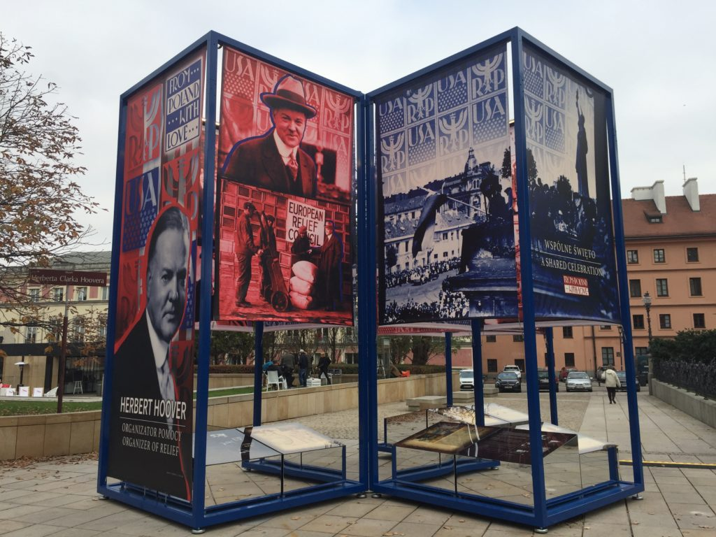 Images of Herbert Hoover on display panels in the From Poland With Love exhibit in Warsaw, Poland